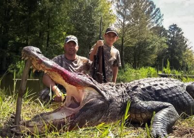 two guys with alligator after hunting in florida
