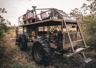 swamp buggy during a spot and stalk hunt in south florida woods