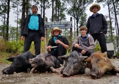 four men with hogs they hunted in florida