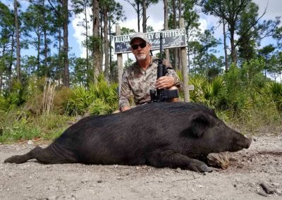 Man with large hog hunted in florida